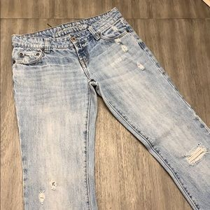 AE size 4 distressed jeans. Wide leg.